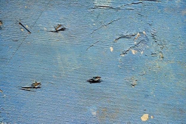 Niebieski drewna ze znakami paznokci