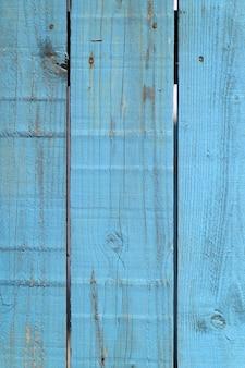 Niebieski drewniany płot tekstura tło
