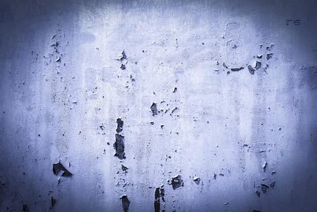 Niebieski, fioletowy, liliowy, tekstura. stare zardzewiałe tła ścienne. szorstkość i pęknięcia. ramka, winieta