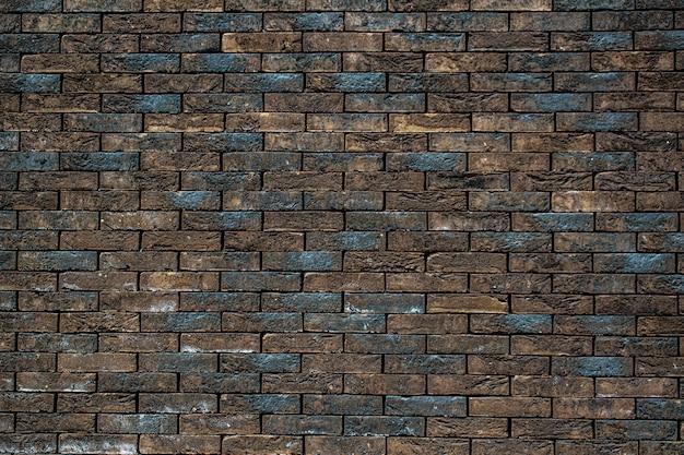 Niebieski i pomarańczowy ceglany mur stary ceglany mur ceglany mur w tle
