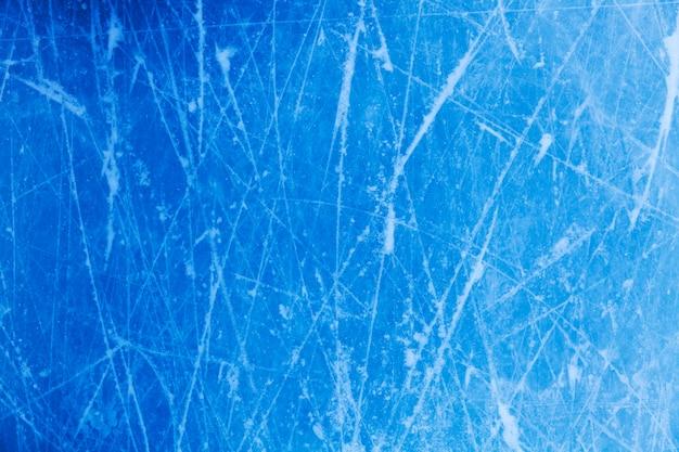 Niebieski lód z pęknięciami. mroźna tekstura. zdjęcie wysokiej jakości