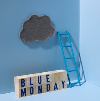 Niebieski poniedziałek z chmurą i drewnianymi kostkami