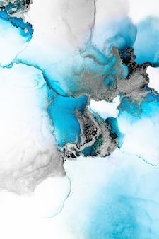 Niebieski srebrny streszczenie tło marmuru płynnym tuszem sztuki malowania na papierze.