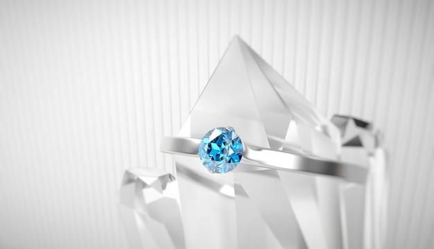 Niebieski szafirowy pierścionek z brylantem w kryształowej miękkiej ostrości