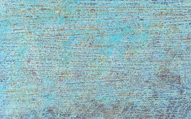 Niebieski tynk tekstura tło z brązowymi zardzewiałymi paskami żelaza. starodawny stary tło powierzchni.