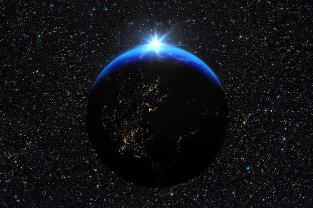 Niebieski wschód słońca, widok ziemi z kosmosu.