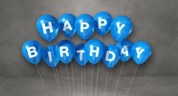 Niebieskie balony z okazji urodzin na scenie szarej powierzchni