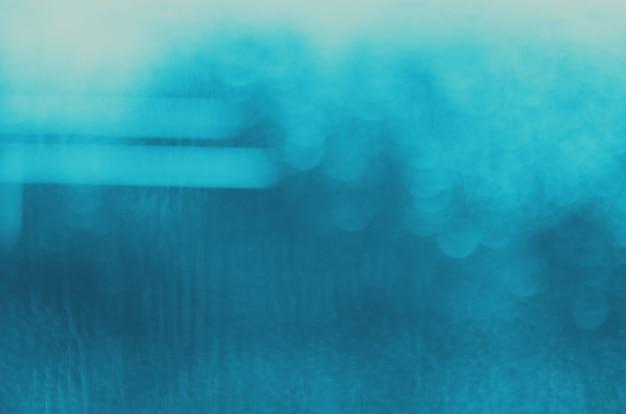 Niebieskie ciemne abstrakcyjne tło w rozmyciu