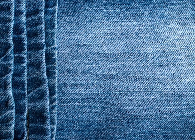 Niebieskie dżinsy i tekstury ściegi. drelichowy tło z szwem