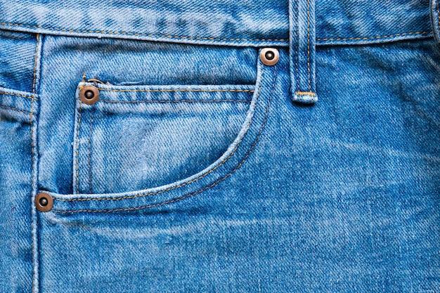 Niebieskie dżinsy kieszeni tekstury tła zbliżenie