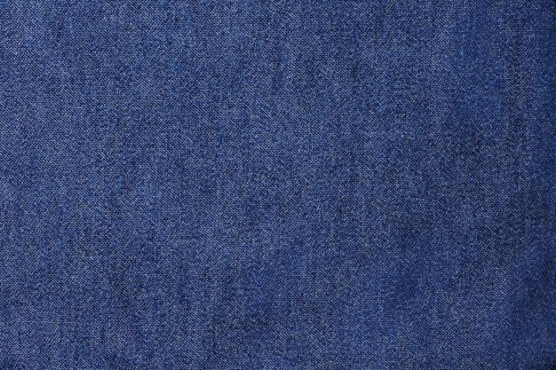 Niebieskie dżinsy lub niebieskie płótno w tle