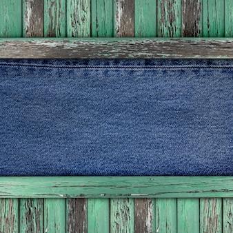 Niebieskie dżinsy tekstury na tle starego drewna