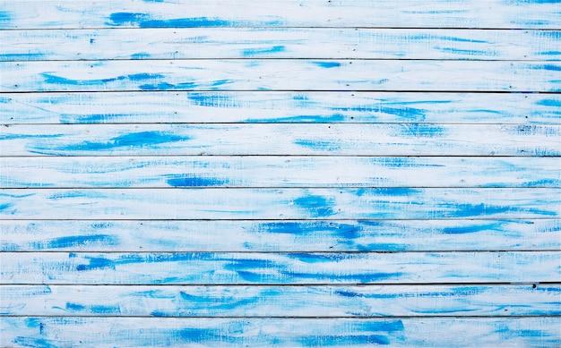 Niebieskie i białe drewniane deski. abstrakcyjne tło