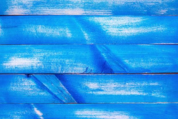 Niebieskie i białe drewniane tekstury tła.