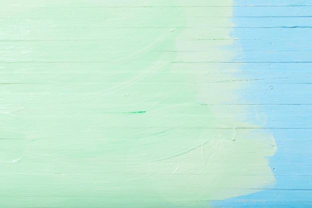 Niebieskie i zielone malowane drewniane tła