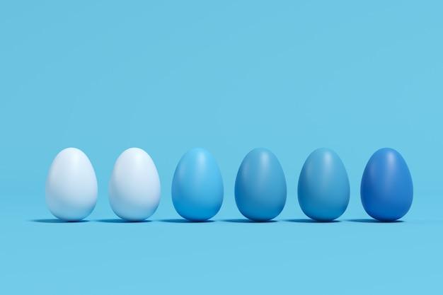 Niebieskie jaja monotonne na niebieskim tle. minimalny pomysł na wielkanoc.