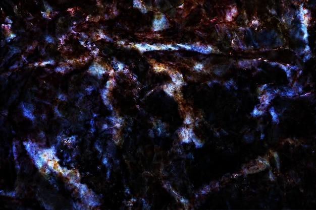 Niebieskie perły mineralne i twarde granitowe marmurowe wnętrza tekstury tła powierzchni