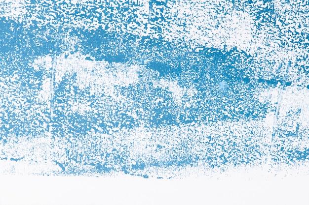 Niebieskie teksturowane szorstkie wydruki tła na tkaninie