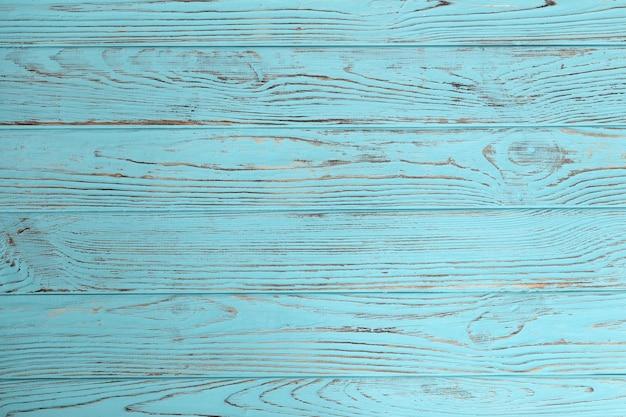 Niebieskie tło drewna. niebieskie drewniane tekstury, puste tło drewna, pęknięta powierzchnia. stare niebieskie drewno