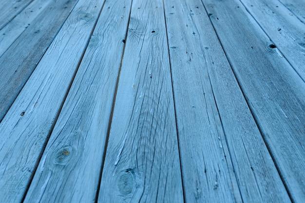 Niebieskie tło drewniane, efekt wieku, stare deski pomalowane na jasnoniebiesko