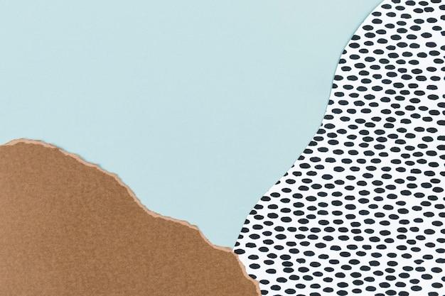 Niebieskie tło ozdobione papierowym kolażem