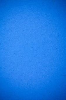 Niebieskie tło recyklingu papieru.