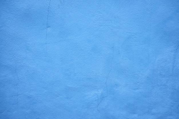 Niebieskie tło ściany brudne cementu.