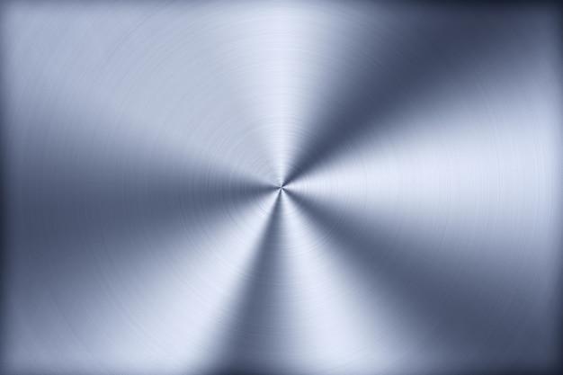 Niebieskie tło technologii z polerowanym, szczotkowanym metalem, radialną fakturą stopu, tytanu, stali, chromu, niklu.