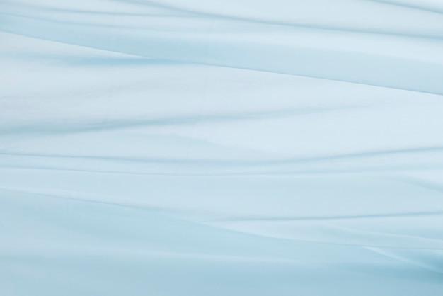 Niebieskie tło tekstury ruchu tkaniny