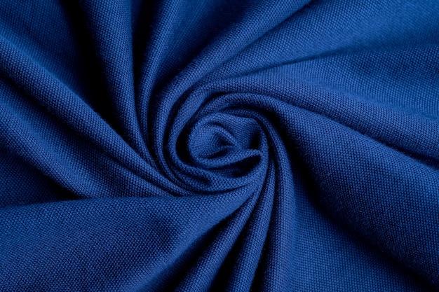 Niebieskie tło tekstury tkaniny, streszczenie, zbliżenie tekstury tkaniny