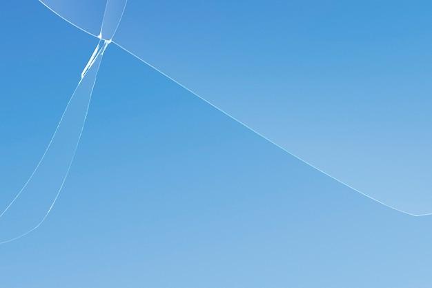 Niebieskie tło z pękniętą teksturą szkła