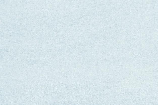 Niebieskie tło z teksturą betonu