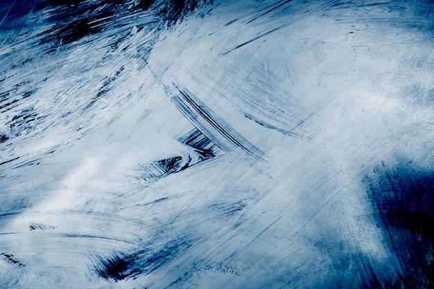Niebieskie tło z teksturą pędzla