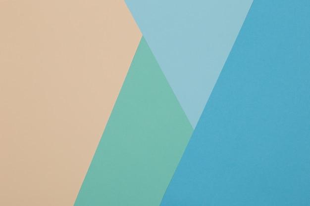 Niebieskie, zielone, żółte tło, kolorowy papier dzieli się geometrycznie na strefy