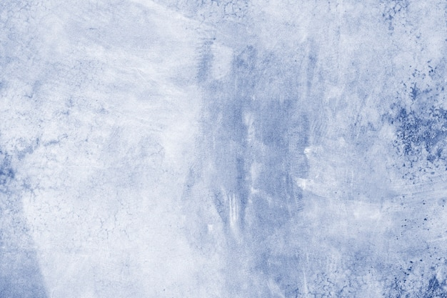 Niebiesko malowane betonowe ściany teksturowane w tle