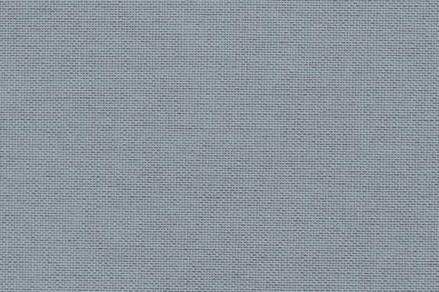 Niebiesko-szara tkanina tekstylna teksturowana tło