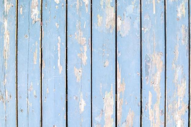 Nieociosany błękitny drewniany tło w rocznika stylu