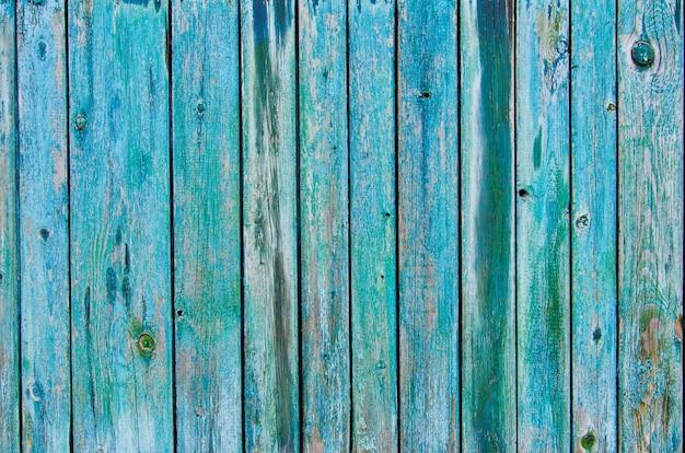 Nieociosany drewniany płotowy tekstury tło zieleni i błękita kolory