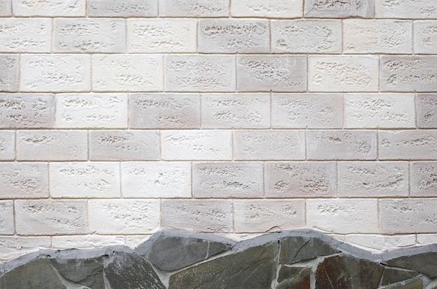 Nieociosany stary beżowy biały ściana z cegieł tło
