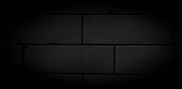 Nieotynkowana czarna ściana z cegły i tekstura tekstura cegły jest czarna