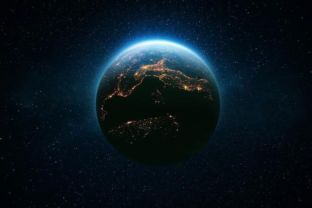 Niesamowita piękna niebieska planeta ziemia z jasnymi nocnymi światłami miasta w gwiaździstej przestrzeni. koncepcja życia. cywilizacja. kosmiczna tapeta.