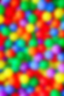 Niewyraźne kolorowe kulki, takie jak obecnie kolorowe plamy ostrości