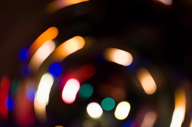 Niewyraźne tło nocy bokeh koncert. światła sceniczne na koncercie. niewyraźne oświetlenie koncertowe. plama streszczenie tło festiwalu