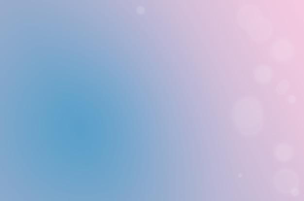 Niewyraźny gradient od niebieskiego do różowego z rozmytymi cząsteczkami
