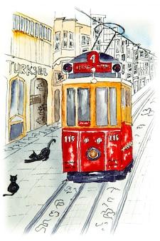 Nostalgiczny czerwony retro tramwaj na słynnej ulicy istiklal.