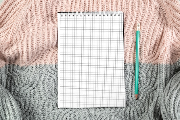 Notatnik na swetrze tekstury
