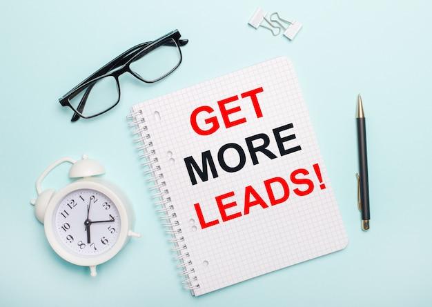 Notatnik ze słowami get more leads.
