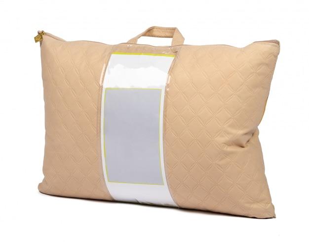 Nowa poduszka w pakowaniu odizolowywającym na bielu