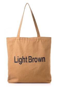 Nowa pusta brown bawełniana torba odizolowywająca na bielu