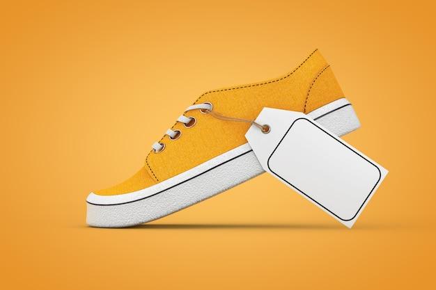 Nowe niemarkowe pomarańczowe trampki dżinsowe z białą pustą makieta z ceną na pomarańczowym tle. renderowanie 3d
